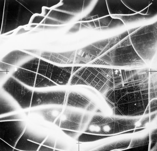 An aerial photograph taken during an air raid on Berlin, with the wavy lines of searchlights and anti-aircraft fire, 1941